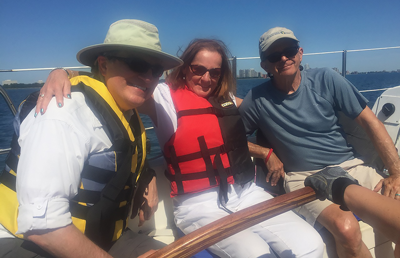 adults sailing