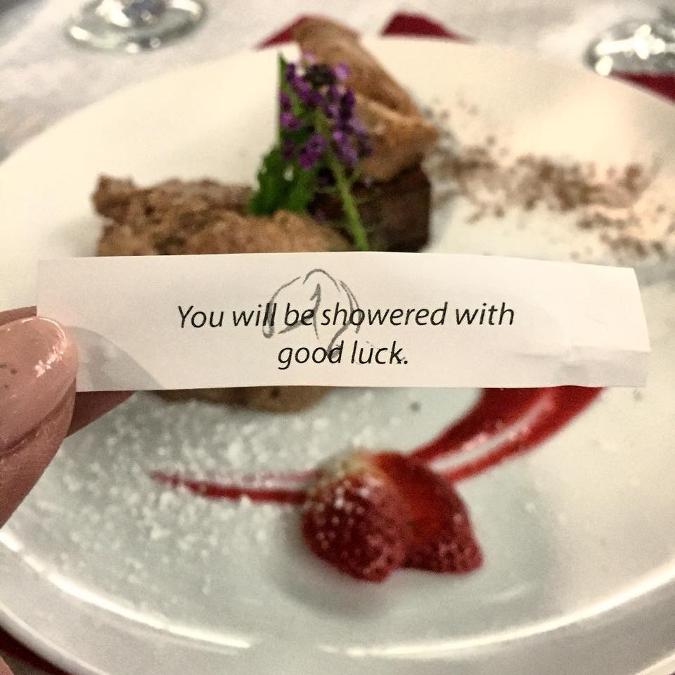 dessert of flourless cake and fortune cookie