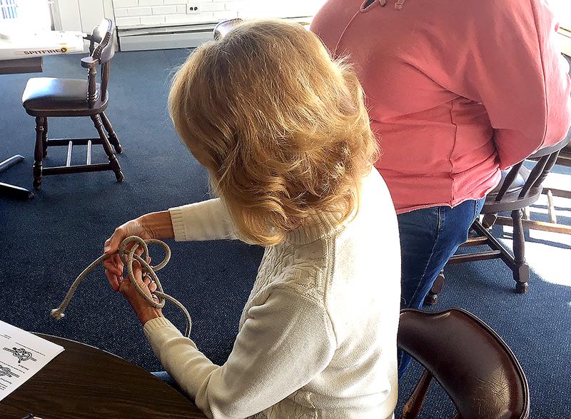 woman tying a bowline