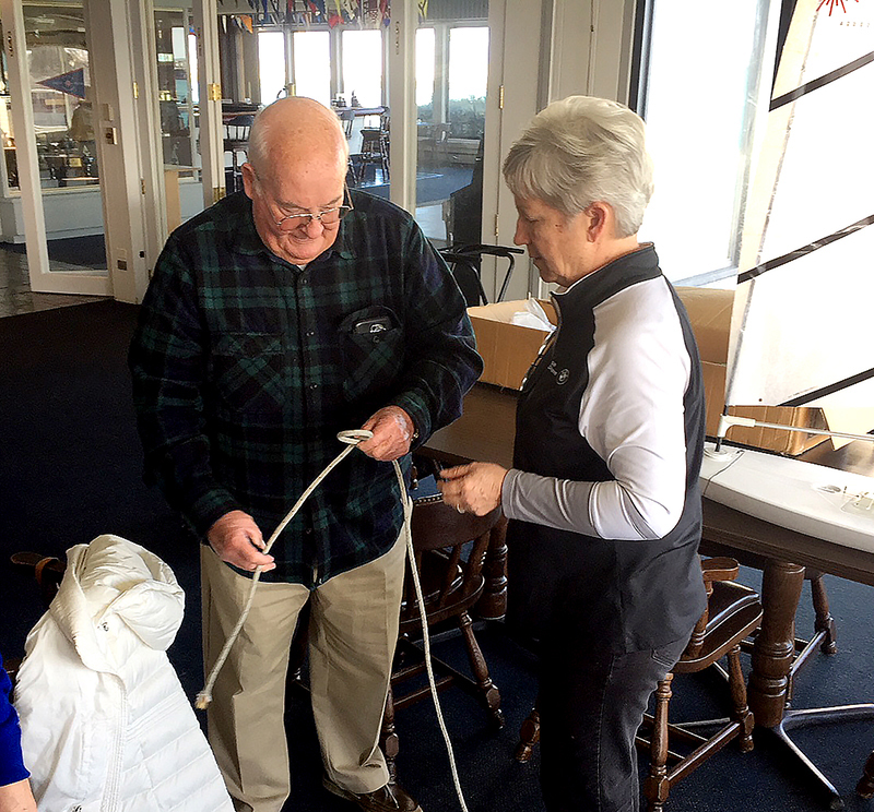 Club commodore demonstrates knot tying