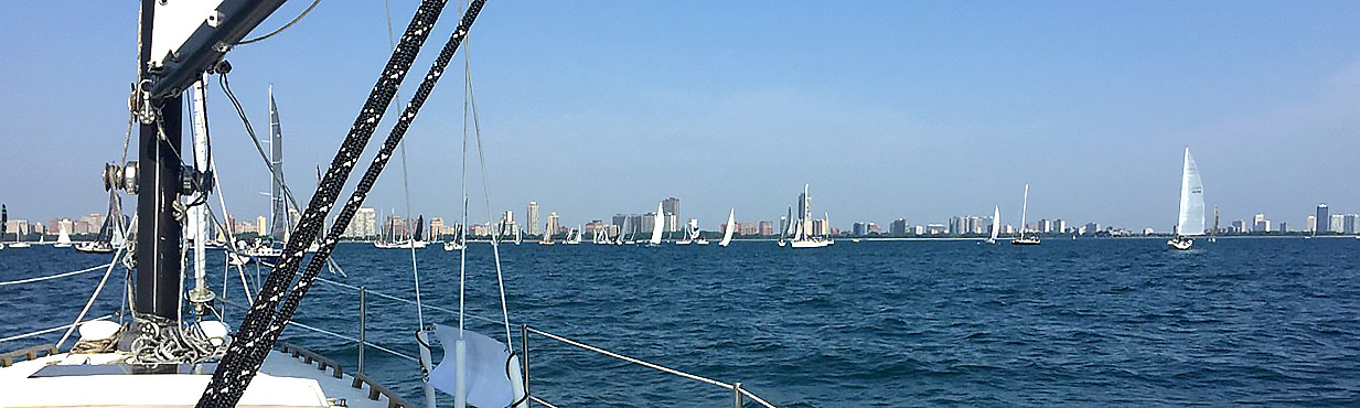 Sailboats preparing to start a race