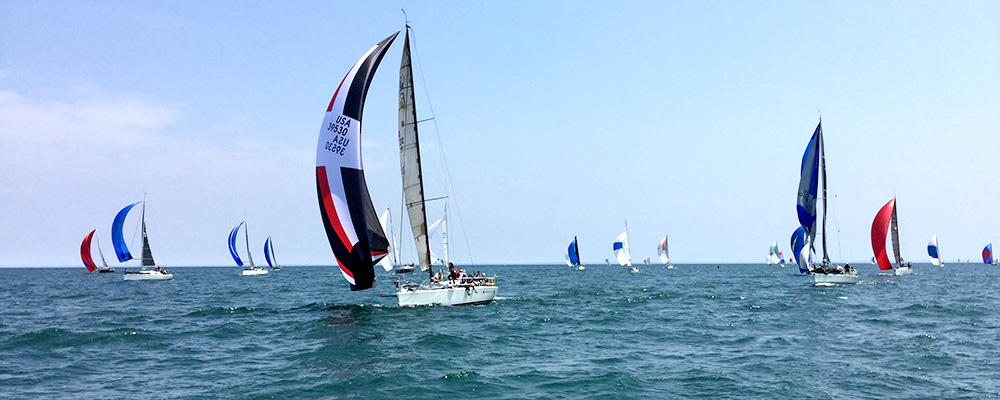 sailboats finishing race with spinnakers