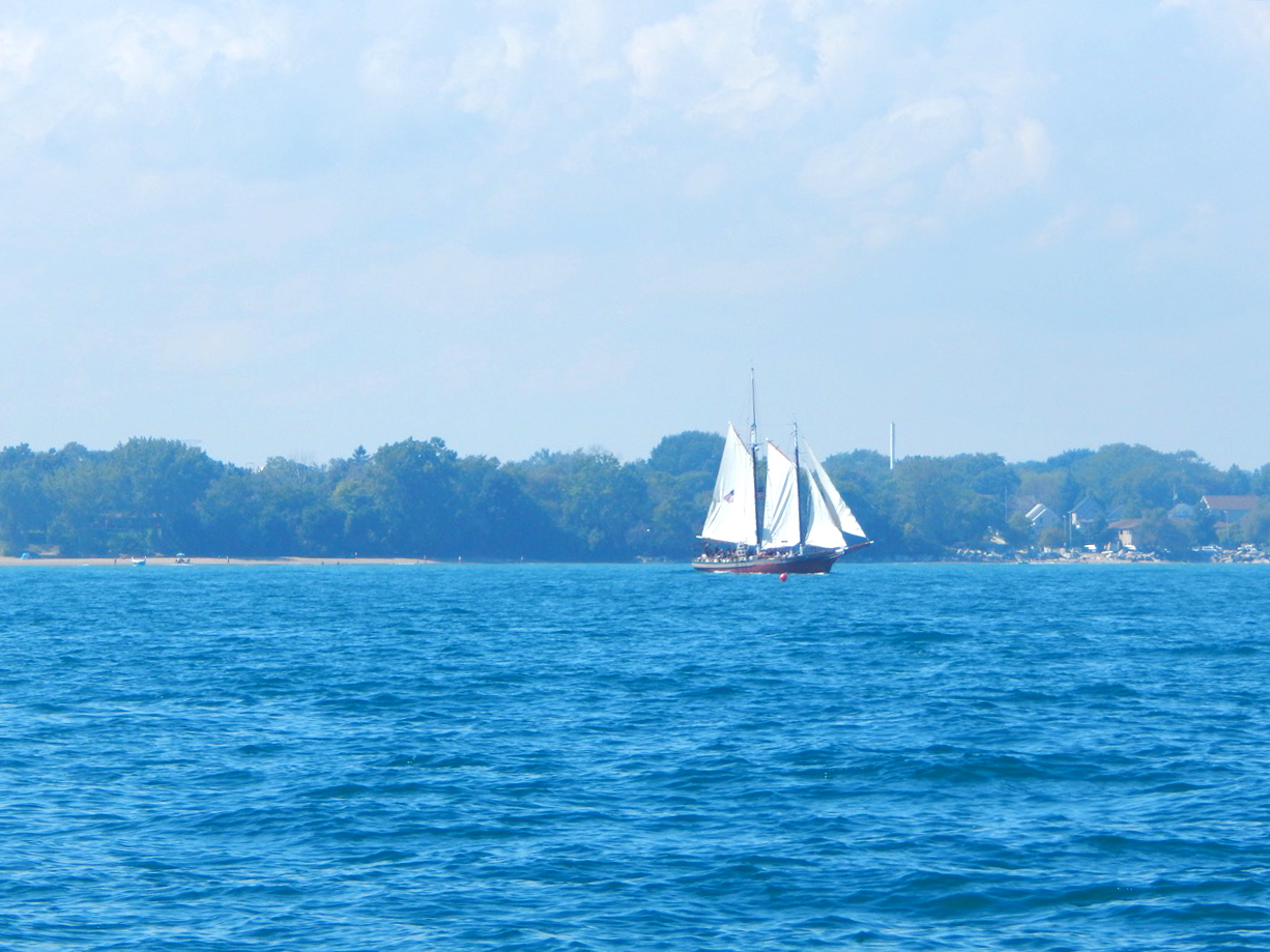 Lanteen-rigged sailboat on Lake Michicgan