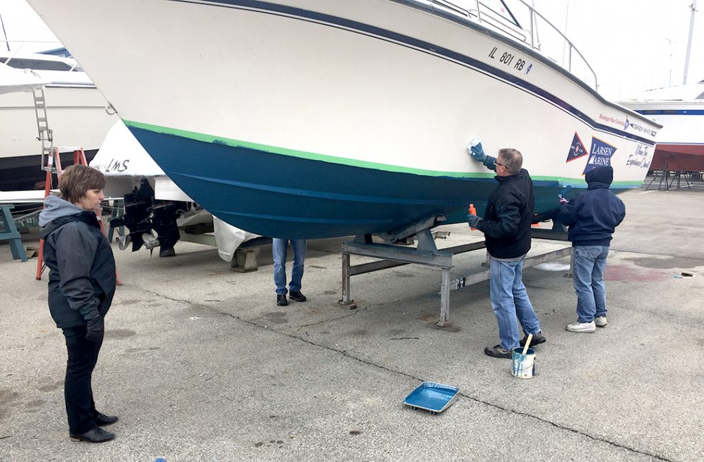 member polishing the hull