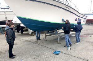member polishing the hull