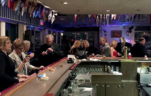 guests gathering at the bar for new years eve
