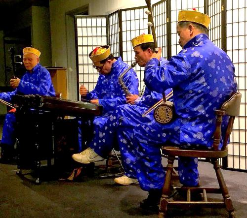 costumed Chinese band performing traditional music